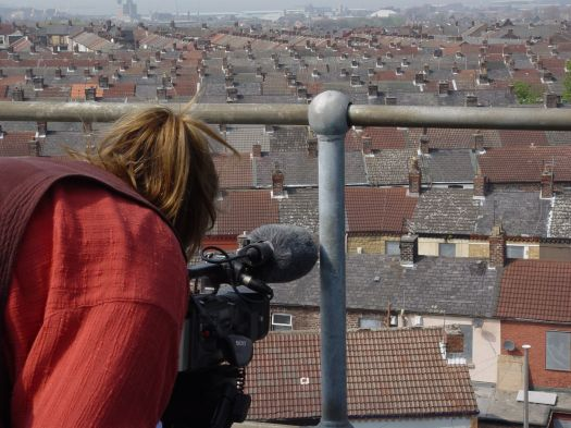 Back in Liverpool, filming Anfield from the roof of the Kop.