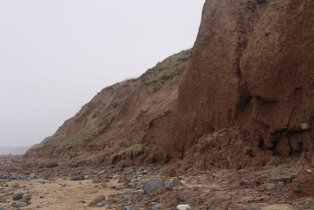 Clumps of boulder clay seeping out onto the beach like molten lava.
