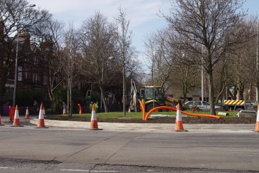 Changing the size of the traffic island. 'Do NOT overtake cyclists' the signs before it warn.