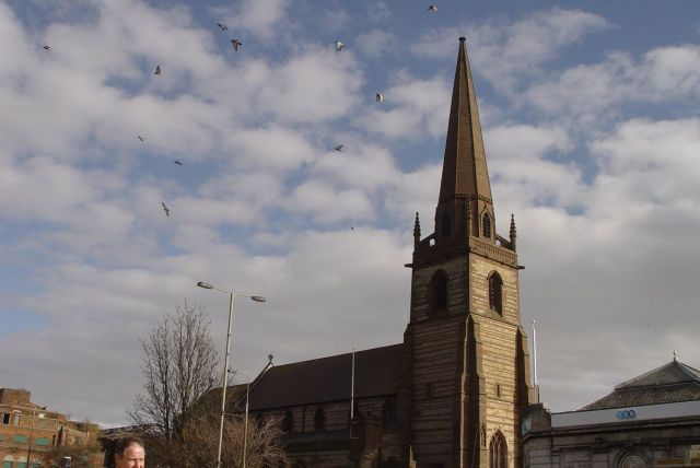 Meanwhile opposite, around St John the Baptist's, the birds are simply showing off.