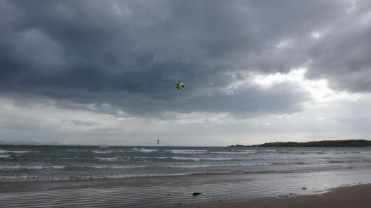A particularly brilliant kite surfer leaping high into the air.