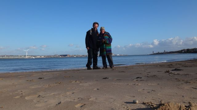 So it's farewell for now, from two happy Liverpool people, on the beach at New Brighton.