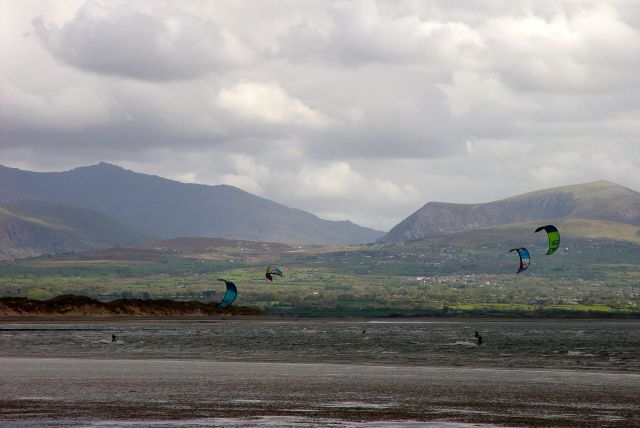 Perfect for kite surfing, with Snowdonia, on the mainland, in the background.