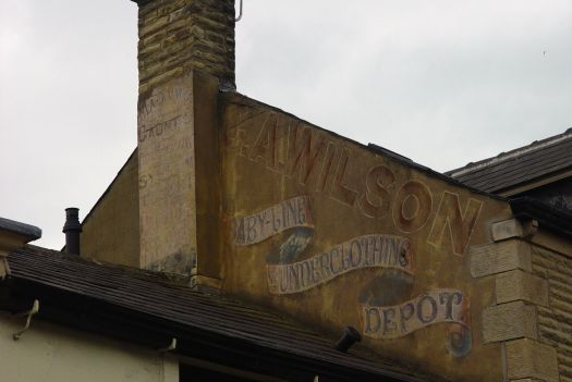 Wonderful ghost-sign above that 'Anna Louise' boutique.