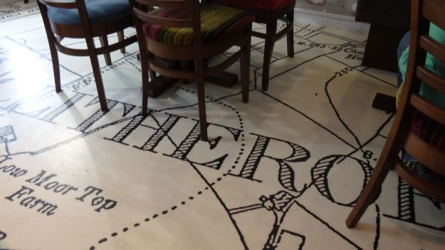 Inside the café the floor is a map of Clitheroe.