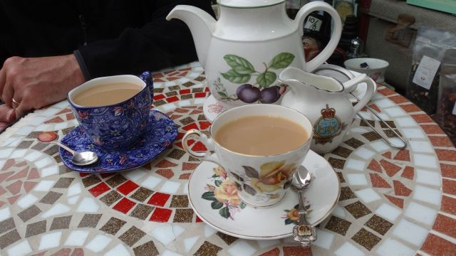 We have our tea and scones outside. Admiring the crockery.