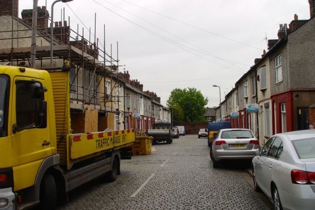 Pausing on the way to notice this tinned up street of empty homes. Arnside Road.