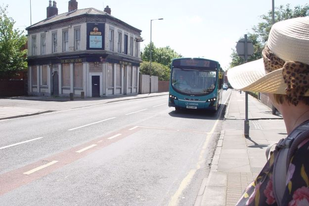 The bus stopping for us. Opposite a closed pub that hasn't found an alternative use yet.