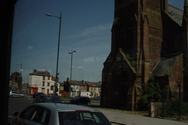 Passing the church on the formerly crowded Edge Lane crossroad.