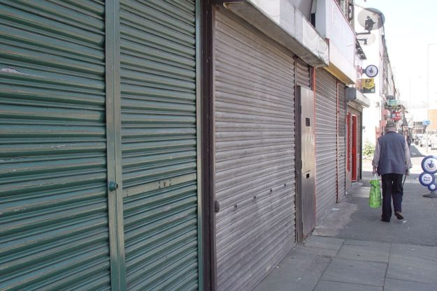 Blighted by the demolitions of the last few years. More shutters than shops.