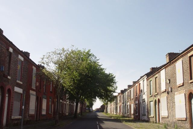Through to the Welsh Streets. The Magical Mystery bus stops so people can gaze at Madryn Street, where Ringo was born.