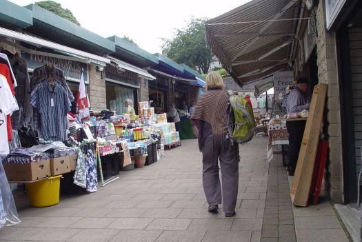We pass through the market.