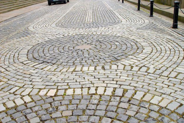 Like the cobbles outside the hall here, being done in the same pattern as the tiled floor inside.