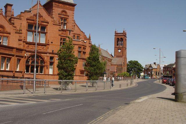 A set of splendid red brick Victorian buildings.