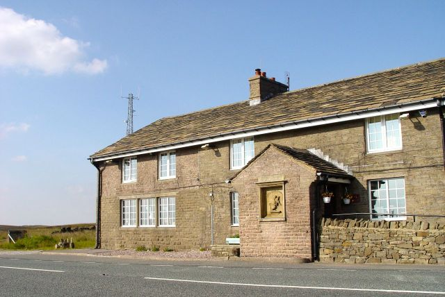 And in a golden evening, at the top of the moor on the Macclesfield Road, we arrive at the Cat & Fiddle