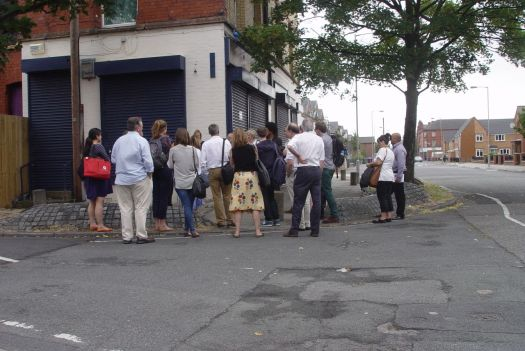 On the corner of Beaconsfield people are starting to gather.