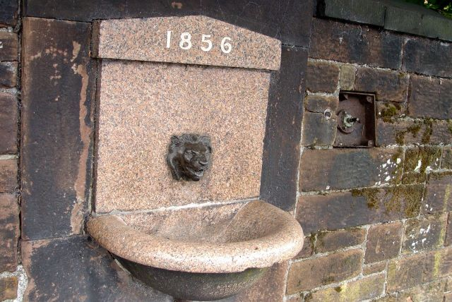 An old drinking fountain along the road. One of the Melly Fountains?