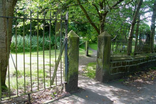 But crossing quiet Woolton Road we're through this gateway to what's now Clarke Gardens.