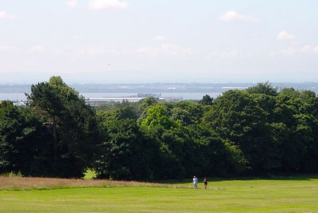 Down the hill, through the woodlands, across the retail park and warehouses, across the river, to the Wirral and Wales.