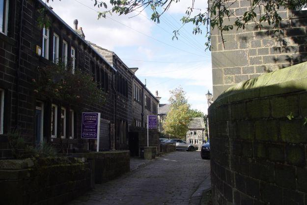 We walk along the narrow streets.