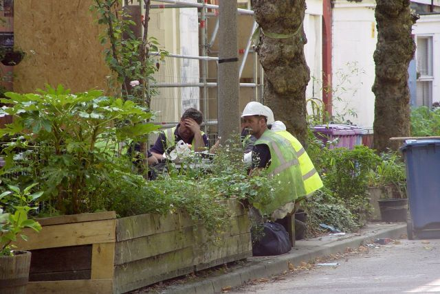 Builders having their lunch where you may be sat on Saturday.