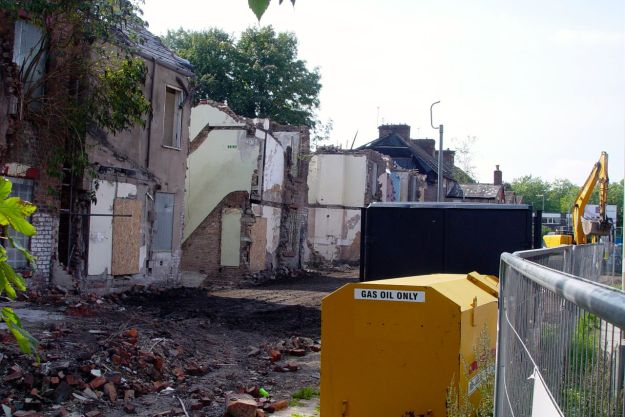 The rest is being carefully demolished, and replaced by virtually new houses.