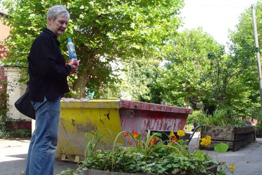 Meanwhile Eleanor does some tidying and gardening before the Street Market.