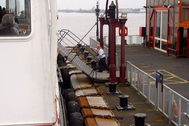 Lowering the gangway by walking on it.