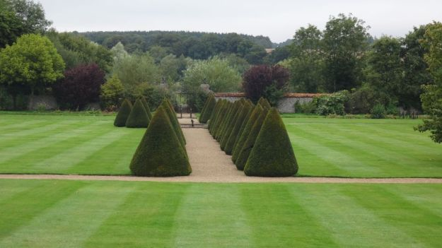With appropriately landscaped gardens.