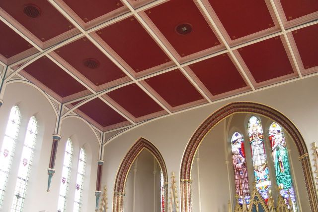 The Fleur de Lys on the ceiling and all around the church are used to explain the French connection.
