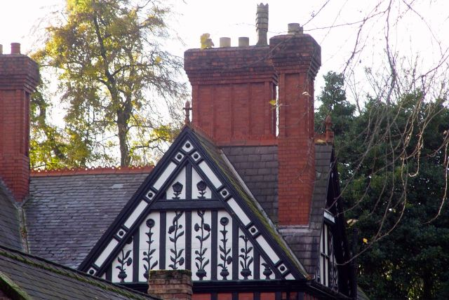 Detail on the large corner house by the Park.