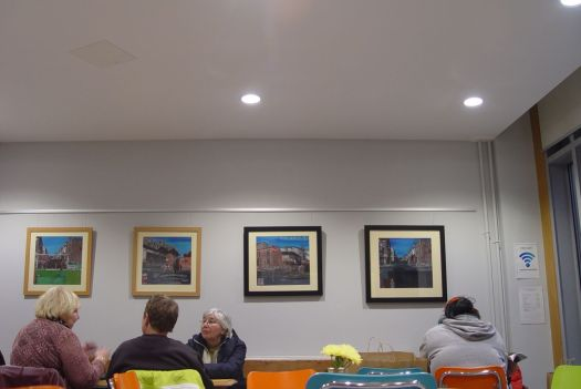 Art all round the walls of The Meeting House Café.