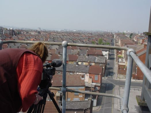 Sarah filming from the roof. Streets now swallowed by the Housing Market Renewal Initiative.