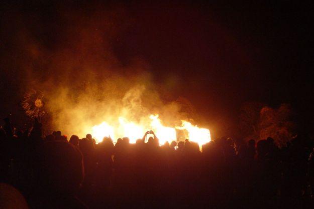 Dancing as the fire burns down.