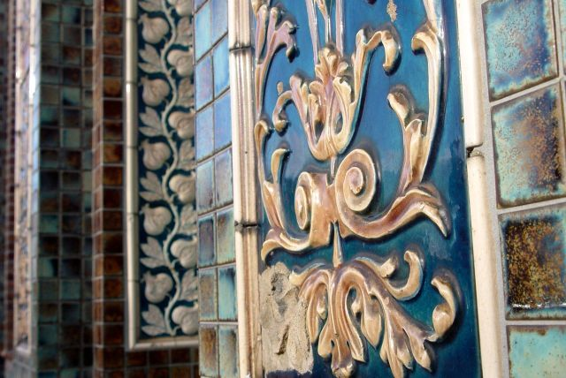 But preserved the splendid tiling for the happy day when it turns back into a pub again.