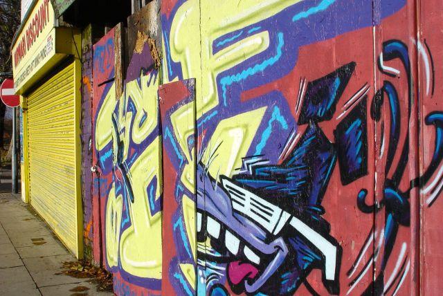 Despite bright art on the shutters of shut shops.