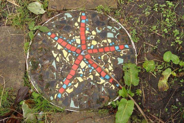 Mosaic bike wheels as paving stones.