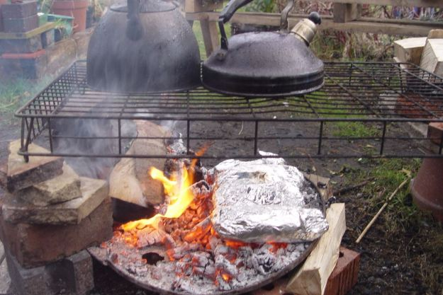 The Cypriot potatoes we bought in Lodge Lane are now making in the embers.
