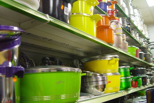 Even the pots and pans reflect the colours from outside the shop.