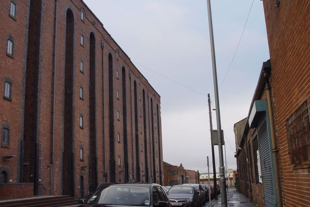 Through streets like canyons of old warehouses being used for new things.
