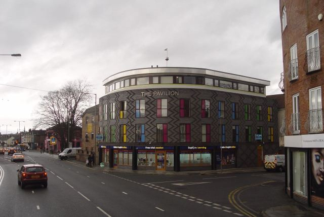 Along Smithdown past the multi-coloured corner building.