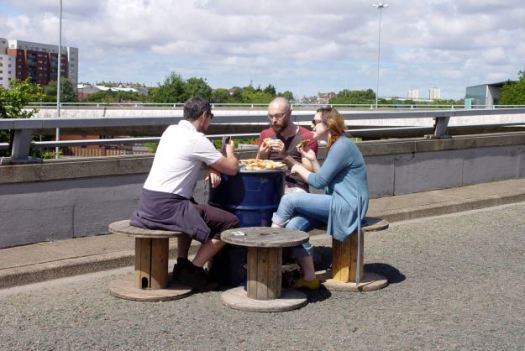 Eating pizzas on the flyover.