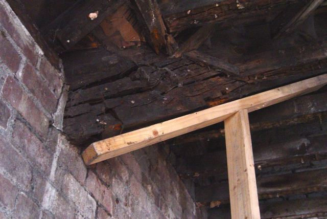 New temporary holding joists supporting rotted timbers for now.