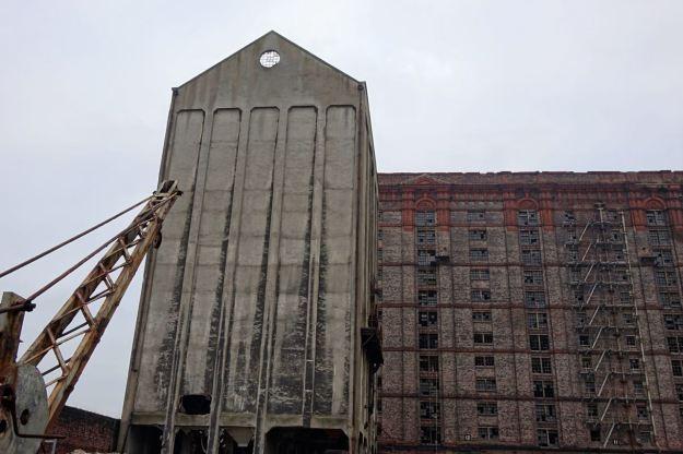 A crane and this concrete building.