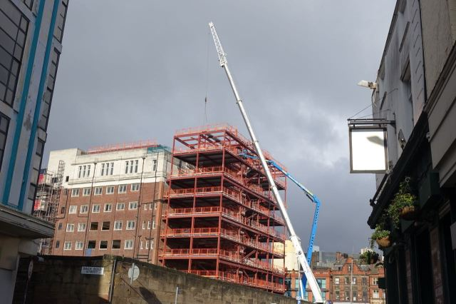 Past Lewis's. Where redevelopment has reached the 'very big crane' stage.