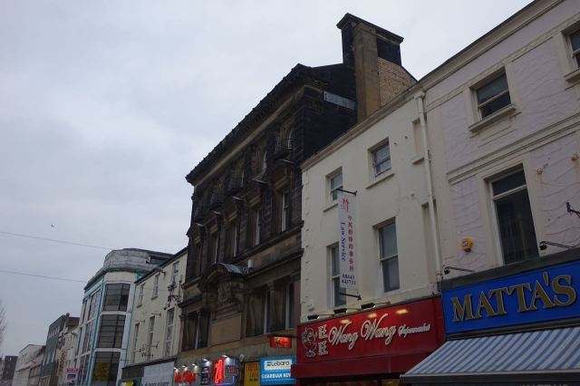 A real ghost sign up there. A bank was here once.