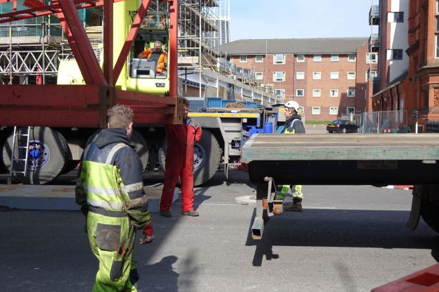 The truck slowly reverses into position.