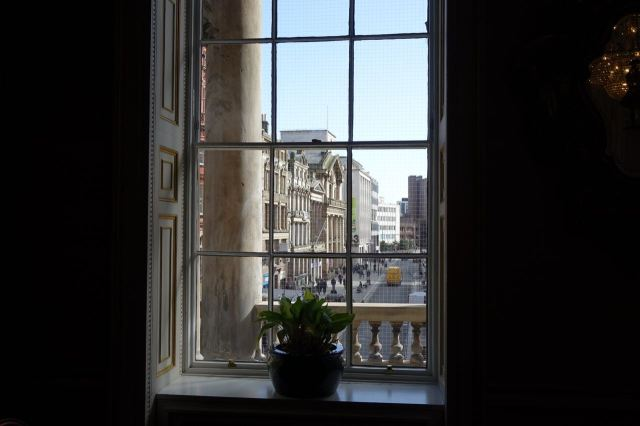 Looking out on the balcony where the great dignitaries of the City have stood: Liverpool and Everton football teams and the Beatles.