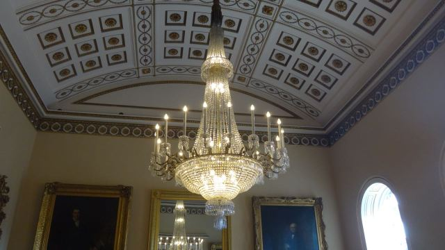 We wander through reception rooms and ballrooms.