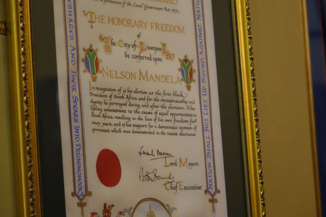 We see Nelson Mandela's Freedom of the City scroll.
